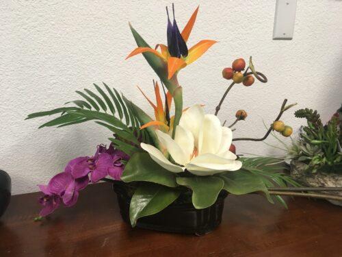 Contact Pacific Silkscapes for BOP, magnolia & orchid arrangement