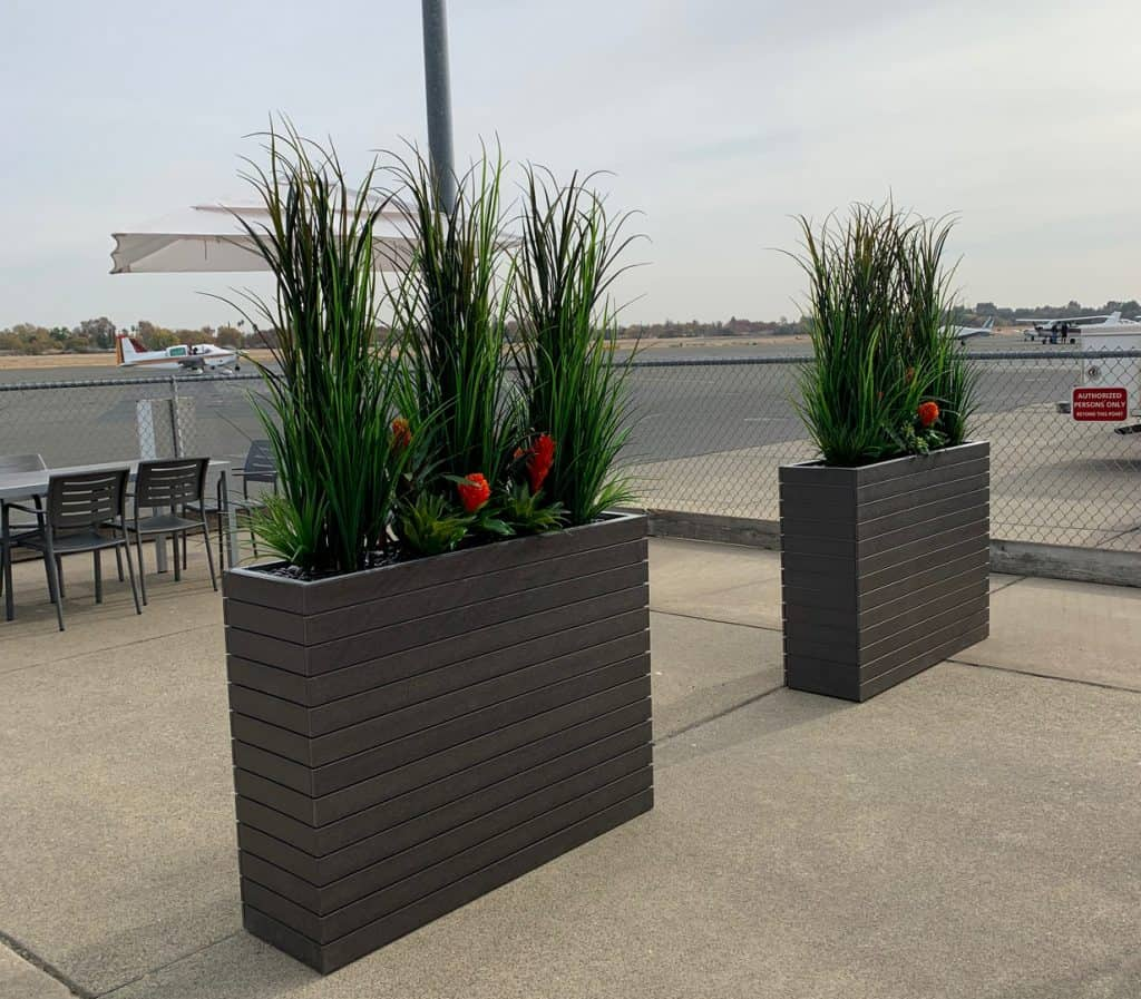 Outdoor artificial grasses with bromeliads